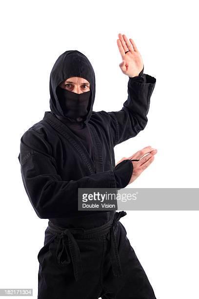 Martial Arts Ninja in Black Threatening Traditional Karate Chop