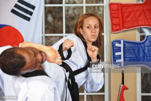 martial arts side kick finish - gerville stock pictures, royalty-free photos & images