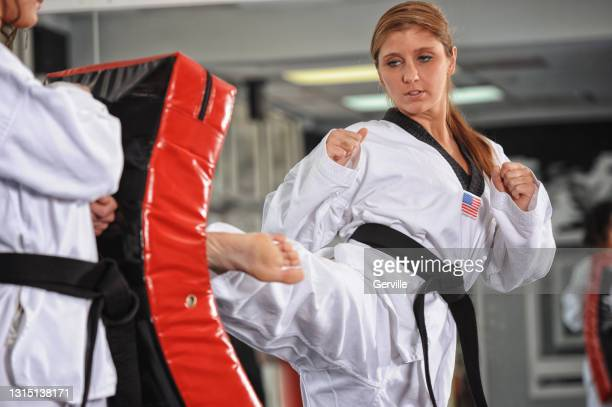 martial arts step side kick - gerville stock pictures, royalty-free photos & images