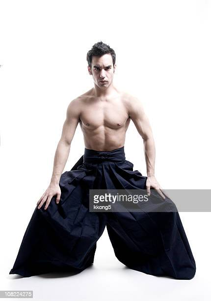 martial arts: young male  wearing kendo pants - asian six pack stock photos and pictures
