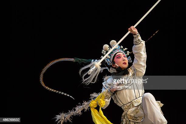 Martial performance of Wudan actress who plays the role of Yang Wenguang in a popular play based on the women generals of the Yang Family legends in...