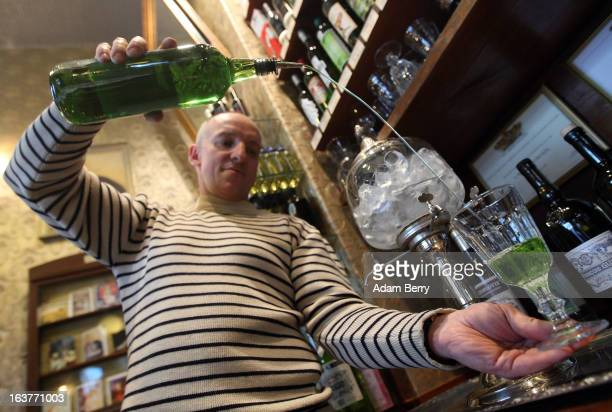 Martial Philippi owner of the Absinth Depot shop pours a glass of absinthe on March 15 2013 in Berlin Germany The highly alcoholic drink absinthe was...