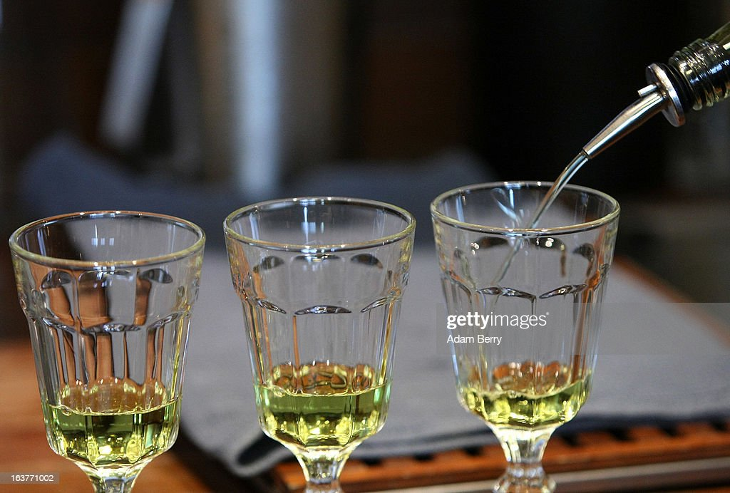 Martial Philippi, owner of the Absinth Depot shop, pours absinthe into glasses on March 15, 2013 in Berlin, Germany. The highly alcoholic drink absinthe was banned in much of Europe during World War I, and only in recent years became once again legal, finding its way back into bars and shops. Meanwhile the European Parliament is divided on its vote on the European Commission's attempt to standardize the definition of the drink by deciding if and how much of the two substances anethole and the chemical thujone, a toxin extracted from wormwood, which has given the drink its reputation for producing mind-altering effects, must be contained within it to officially classify versions of the 'green fairy,' as it is also known, with the absinthe name.