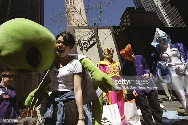 Martians from the restaurant Mars 2112 arrive with lunch for people lined up outside the Ziegfeld Theater for tickets to 'Star Wars Episode 1 The...