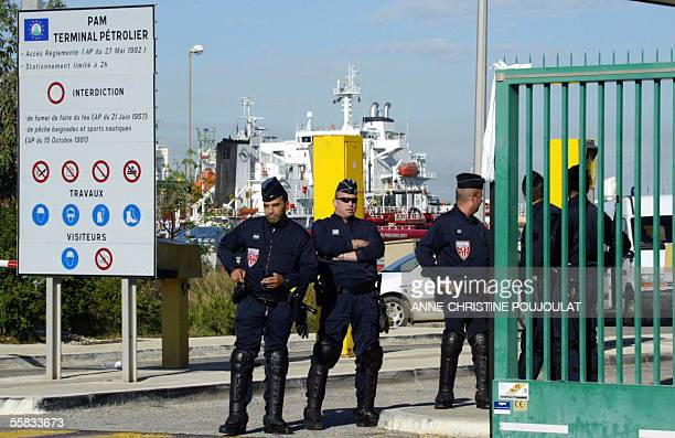 French police officers stand at the entry of Lavera's oil terminal to grant the access of the plant despite the strike of the dockers 1st October...