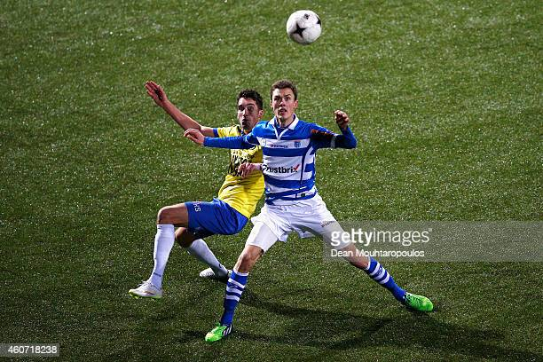 Martijn Barto of Cambuur and Thomas Lam of Zwolle battle for the ball during the Dutch Eredivisie match between SC Cambuur and PEC Zwolle at Cambuur...