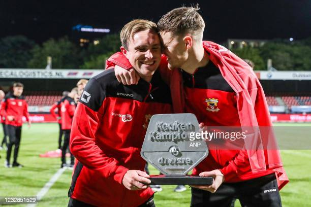 Martijn Berden of Go Ahead Eagles, Sam Beukema or Go Ahead Eagles celebrate the promotion during the Dutch Kitchen champion division match between...