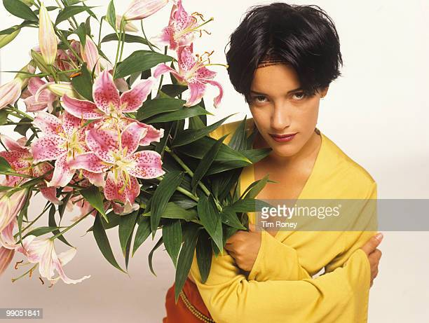 Martika singer holding a bunch of flowers circa 1990