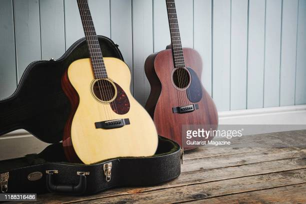 Martin 000-14 Fret Sitka Top acoustic guitar and a Martin 000-14 Fret Mahogany Top acoustic guitar, taken on March 26, 2019.