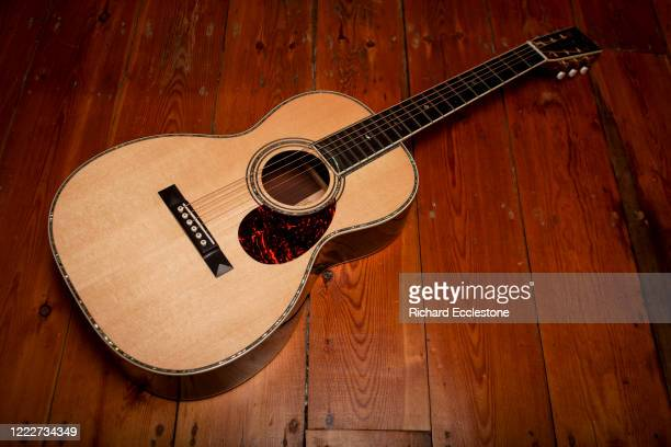 Martin 00-42SC John Mayer acoustic guitar. This '00' 12-fret guitar boasts solid cocobolo sides, back and headplate, inspired by the Martin 00-45SC...