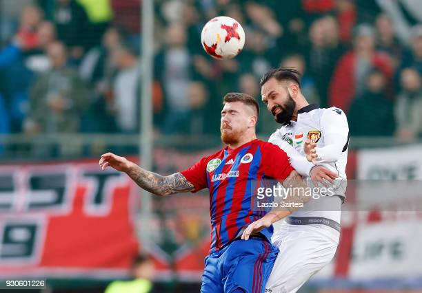 Martin Adam of Vasas FC battles for the ball in the air with Tomas Kosut of Budapest Honved during the Hungarian OTP Bank Liga match between Vasas FC...