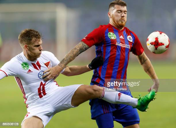 Martin Adam of Vasas FC competes for the ball with Balazs Benyei of DVSC during the Hungarian OTP Bank Liga match between Vasas FC and DVSC at Ferenc...