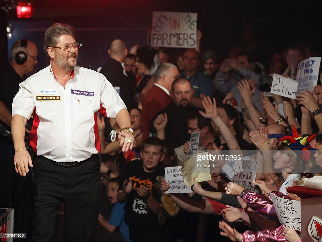 Martin Adams of England arrives on stage to play in the BDO World