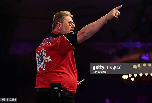 Martin Adams of England bids farewell to the crowd following defeat during his Mens Quarter Final match against Jamie Hughes of England on day seven...