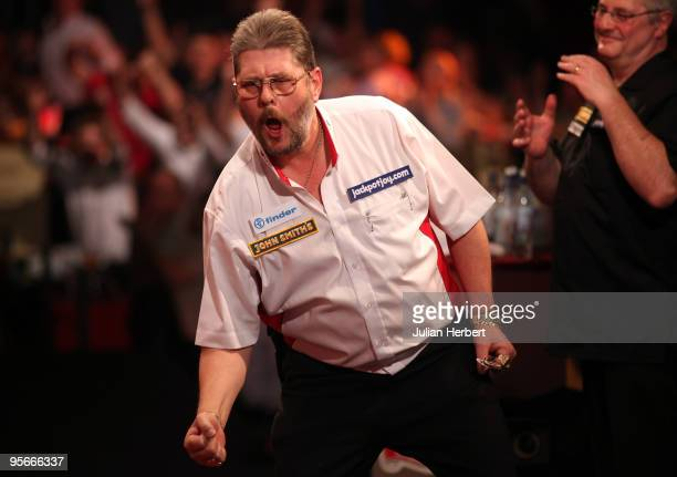 Martin Adams of England celebrates his victory against Martin Phillips of Wales after the Semi Final of The World Professional Darts Championship at...