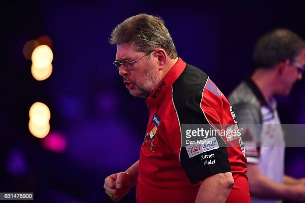 Martin Adams of England celebrates victory during his Mens' second round match against Jeff Smith of Canada on Day Five of the BDO Lakeside World...