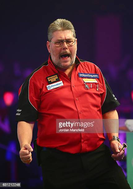 Martin Adams of England celebrates victory in his Men's First Round match against Ryan Joyce of England on Day Two of the BDO Lakeside World...