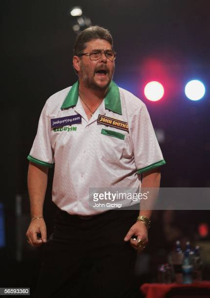 Martin Adams of England celebrates winning a set as he plays Raymond Van Barneveld of Netherlands during the semi finals of BDO World Darts...