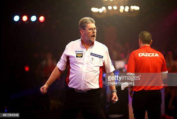 Martin Adams of England celebrates winning a set during his semi final match against Glen Durrant of England during the BDO Lakeside World...