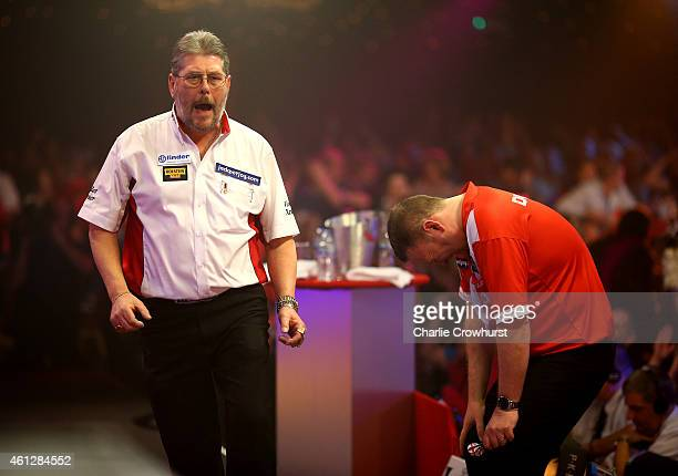 Martin Adams of England celebrates winning a set during his semi final match against Glen Durrant of England who looks dejected during the BDO...