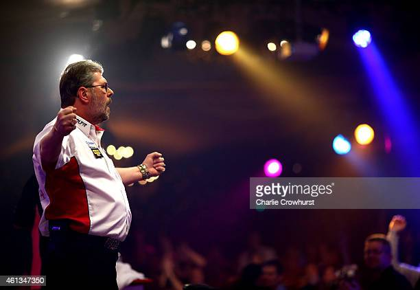 Martin Adams of England celebrates winning a set during the mens final against Scott Mitchell of England during the BDO Lakeside World Professional...