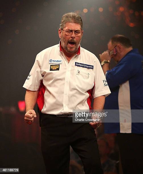 Martin Adams of England celebrates winning his first round match against Tony O'Shea of England during one of the BDO Lakeside World Professional...