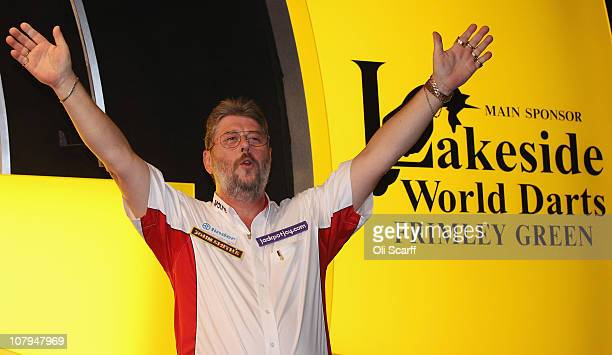 Martin Adams of England celebrates winning the BDO World Darts Championship final against Dean Winstanley of England at the Lakeside Country Club on...