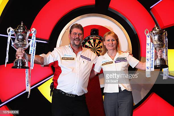 Martin Adams of England celebrates winning the BDO World Darts Championship final with Trina Gulliver of England winner of the previous day's BDO...