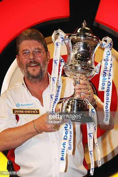 Martin Adams of England celebrates with the trophy after winning the BDO World Darts Championship final against Dean Winstanley of England at the...