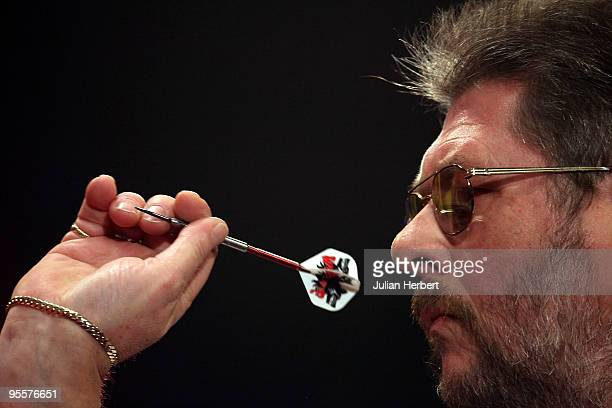 Martin Adams of England in action against Anthony Fleet of Australia during the first round Match of World Professional Darts Championship at The...