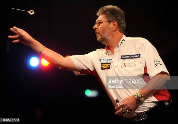 Martin Adams of England in action against David Cameron of Canada on day one of the BDO Lakeside World Professional Darts Championships at Lakeside...