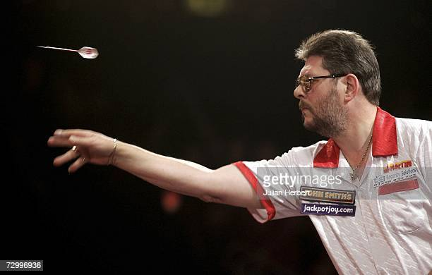 Martin Adams of England in action against Phil Nixon of England during the Final Of The BDO World Darts Championships at the Lakeside Country Club on...