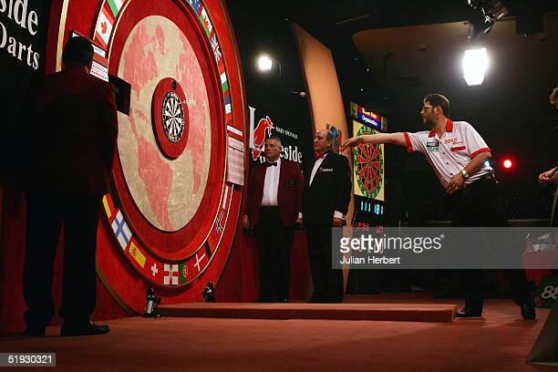 Martin Adams of England in action against Raymond Van Barneveld of Holland during the final of The British Darts Organisation World Professional...