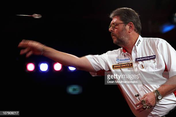 Martin Adams of England in action against Ross Smith of England in the Quater Finals on Day 6 of the Lakeside World Professional Darts Championships...