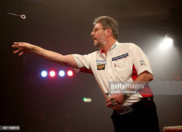 Martin Adams of England in action during his first round match against Tony O'Shea of England during one of the BDO Lakeside World Professional Darts...