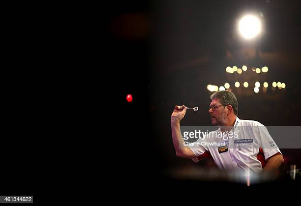 Martin Adams of England in action during the mens final against Scott Mitchell of England during the BDO Lakeside World Professional Darts...