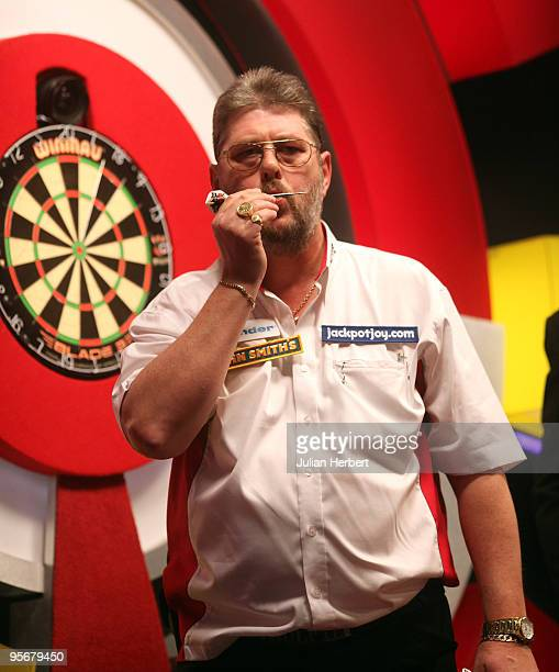 Martin Adams of England kisses a dart after beating Dave Chisnall of England in the Final of The World Professional Darts Championship at The...