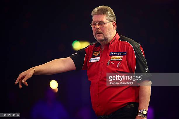 Martin Adams of England looks dejected during his Men's First Round match against Ryan Joyce of England on Day Two of the BDO Lakeside World...