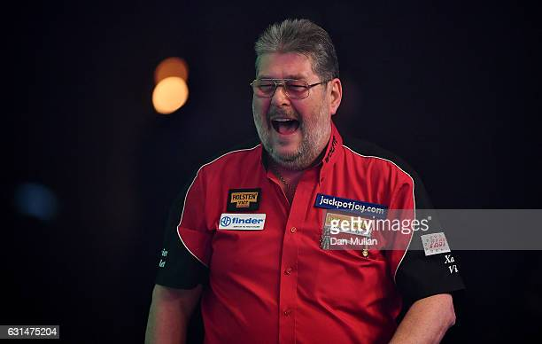 Martin Adams of England makes his way on stage for his Mens' second round match against Jeff Smith of Canada on Day Five of the BDO Lakeside World...