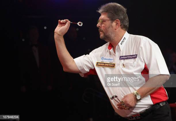 Martin Adams of England plays in the BDO World Darts Championship final against Dean Winstanley of England at the Lakeside Country Club on January 9...