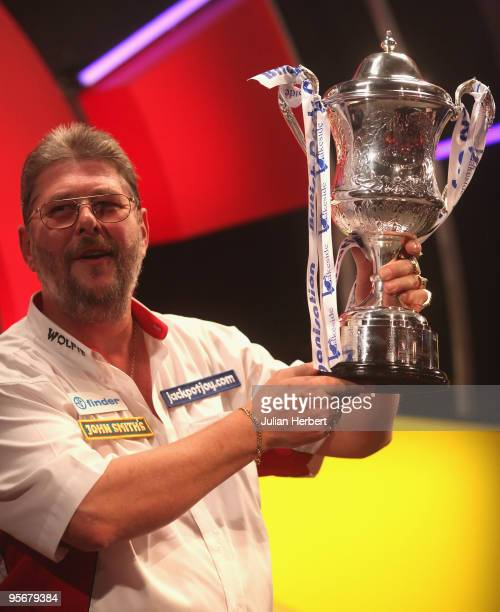 Martin Adams of England poses with the trophy after beating Dave Chisnall of England in the Final of The World Professional Darts Championship at The...