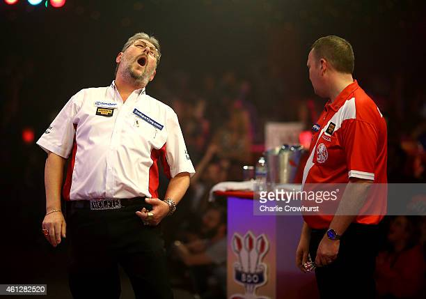 Martin Adams of England reacts after going one dart away from hitting a nine darter during his semi final match against Glen Durrant of England...