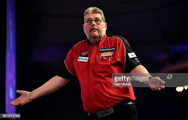 Martin Adams of England reacts during his Mens Quarter Final match against Jamie Hughes of England on day seven of the BDO Lakeside World...