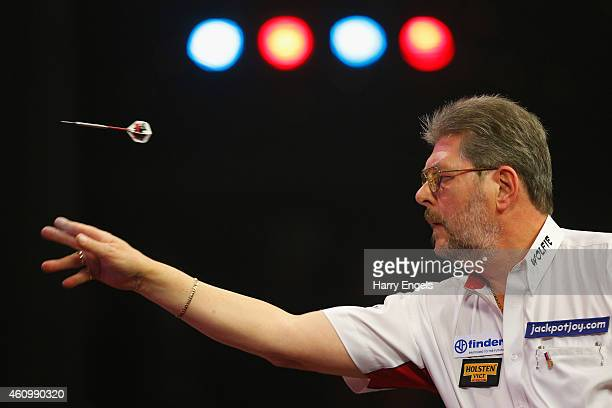 Martin Adams of England throws during his first round match against Jan Dekker of the Netherlands on day one of the BDO Lakeside World Professional...