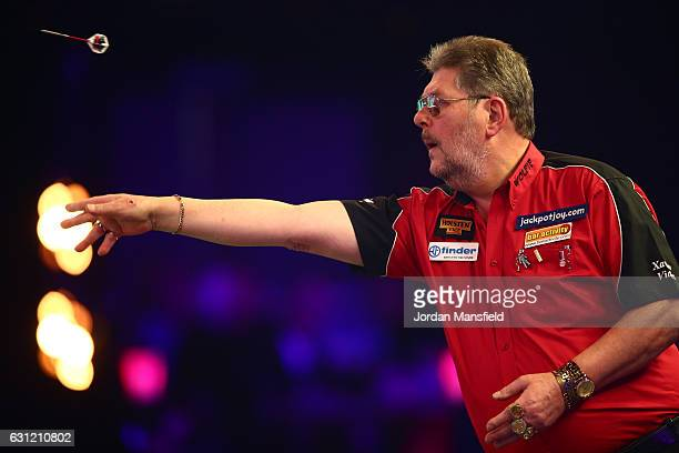 Martin Adams of England throws during his Men's First Round match against Ryan Joyce of England on Day Two of the BDO Lakeside World Professional...