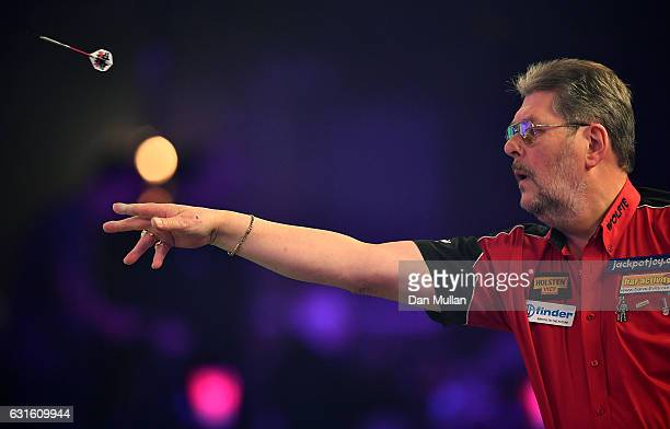 Martin Adams of England throws during his Mens Quarter Final match against Jamie Hughes of England on day seven of the BDO Lakeside World...