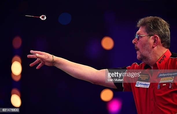 Martin Adams of England throws during his Mens' second round match against Jeff Smith of Canada on Day Five of the BDO Lakeside World Professional...