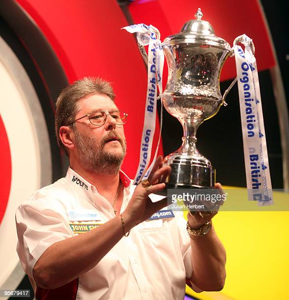 Martin Adams of England with the trophy after beating Dave Chisnall of England in the Final of The World Professional Darts Championship at The...