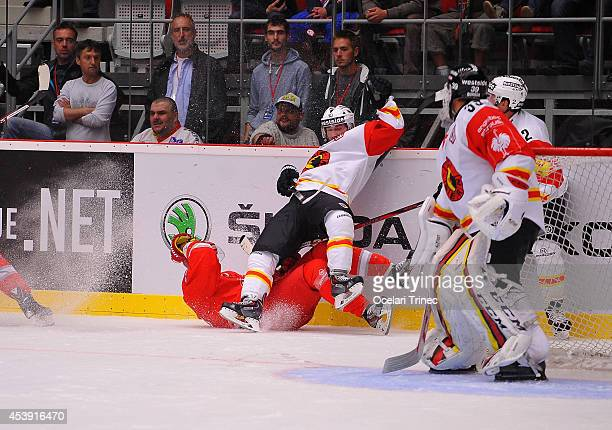 Martin Adamsky of HC Ocelari Trinec and Tristan Scherwey of SC Bern during the Champions Hockey League group stage game between HC Ocelari Trinec and...
