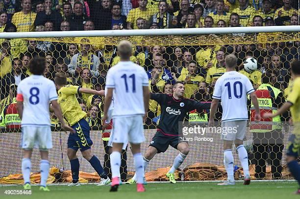 Martin Albrechtsen of Brondby IF scores the 10 goal against Goalkeeper Stephan Andersen of FC Copenhagen during the Danish Alka Superliga match...